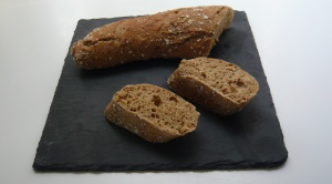 The distinctive holes in the bread are typical for sourdough